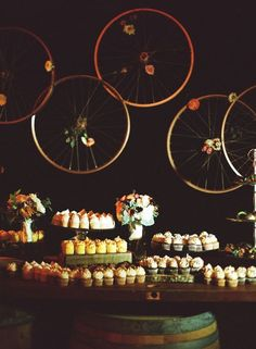hanging bicycle wheels wedding dessert decor / http://www.himisspuff.com/bicycle-wedding-ideas/6/