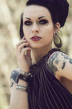 Medusa lips piercing Bats tattoos piercings
