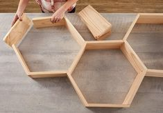 How to DIY Your Own Honeycomb Wall Shelves : laying out boards in hexagon pattern Hexagon Wall Shelf, Honeycomb Shelves, Diy Wood Projects, Home Projects, Diy Regal, Diy Casa, Diy Tumblr, Boho Living Room, Living Room Wall Decor