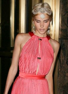 Isabel Lucas in Louis Vuitton | Met Gala 2011. Beautiful head piece with matching earrings.