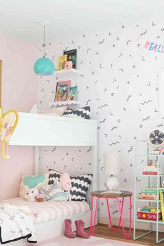 kids room with fun wallpaper