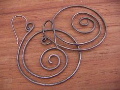 Pure Copper Swirl Earrings. $18.00, via Etsy.