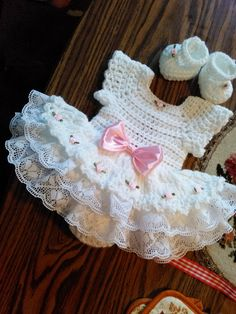 White crochet Rosebud baby dress set.