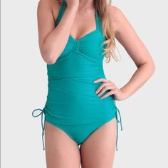 Ruche Maggie May teal swim suit Looks like a tankini but the top and bottom are connected. Flattering fit. Only worn once. Fits like an 8 Ruche Swim One Pieces