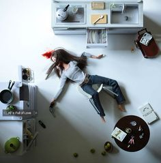 In her photo series called 'Play Dead', photographer Mariel Clayton shows us Barbie 'committing suicide' by cutting her wrist, suffocation, stabbing and shooting herself in the head.