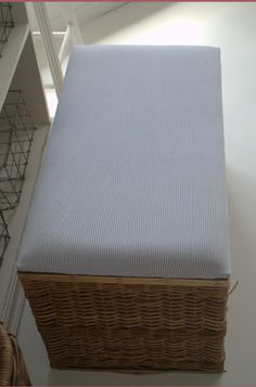 Upholster the top of an old wicker trunk for a great new ottoman! I would put a thin MDF board down first.