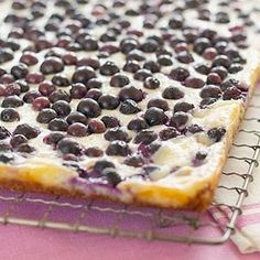 An abundance of colorful blueberries dot this spectacular cheesecake dessert recipe.
