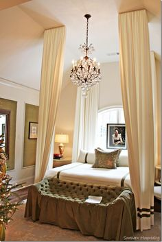 """Master bedroom, four """"poster"""" fabric bed, tufted bench, chandelier"""