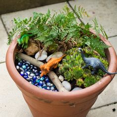 Dinosaur small world in a flower pot Dinosaur Small World, Dinosaur Land, Small World Play, Dinosaurs, Tuff Tray Ideas Toddlers, Fun Projects For Kids, Blue Food Coloring, Barnyard Animals, Homemade Playdough