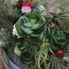 This autumn arrangement combines shapely, edible showstoppers like cabbage, pomegranates, and artichokes alongside dahlias and amaranth (Amaranthus).