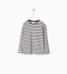 Love the fit of these shirts from Zara! Loose and long enough for your girls to play and jump!