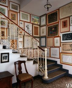 The villa's staircase boasts works by Pablo Picasso, max Ernst, Giorgio De Chirico, and Antonio Sant'Elia hanging alongside pieces by Baj | archdigest.com