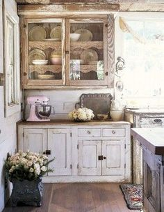 Love the distressed look of these cabinets. If we distressed them, we could leave all the handles and hinges alone! LESS WORK!