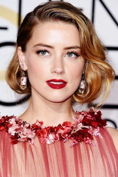 """Pro Secrets Behind 11 Of The Raddest Updos In Hollywood #refinery29 http://www.refinery29.com/updo-hairstyles#slide-7 A Faux Bob When hairstylist Jon Chapman saw Amber Heard's delicate dress for the Golden Globes, he instantly thought her hair had to have a rock-and-roll Grace Kelly look. """"It has such an incredible neckline that I didn't want anything to be messing with that,"""" he says...."""
