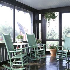 Update your porch with a fresh coat of paint. The floor of this porch was painted combination of one part brown and two parts black to give it a rich chocolate color. Black trim complements the look, and green rocking chairs add a splash of color.
