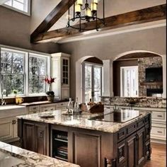 Gorgeous Kitchen #kitchen #woodbeams #thinkbig #hardwoodfloors #kitchendesign #instapic #homedecor #granite #granitecounters #dreambig #dreamhome #home #homes #bighome #bighomes #walnut #cabinets #appliances #realestate #millionaire #yes #entrepreneur #baller #balleralert #boss #anastasiabeverlyhills #goals #business