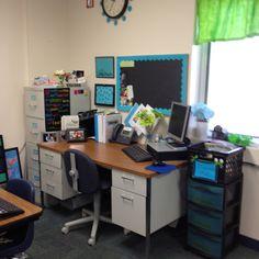 Teacher desk against wall.
