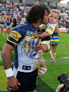 Johnathan Thurston of the Cowboys kisses his daughter Frankie at the start of the round seven NRL match between the North Queensland Cowboys and the New Zealand Warriors at 1300SMILES Stadium on April 18, 2015 in Townsville, Australia.