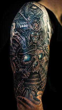 Samurai tattoo with skull armor. - The blue ink of this tattoo makes it look alive. The details are incredible despite its size, which is only half sleeve. #TattooModels #tattoo