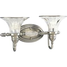 Progress Lighting P2726-101 2-Light Bath Bracket, Classic Silver by Progress Lighting. $185.31. From the Manufacturer                With the spirit and elegance of an early Hollywood ballroom, the truly spectacular Roxbury Collection features a sophisticated combination of clear crystal glass and a Classic Silver finish. Whether in a center column or bobeches, crystal accents correspond with each shade, while detailed arms and rings visually frame the crystal. 2-Light ...