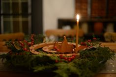 Advent- Waiting for the coming of Christ. First candle of Advent = hope. Is.11:1-2