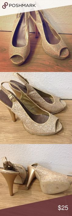 Heels These heels first of all are one of my favorite pairs. And they are gold and glittery!!!! Who doesn't love glitter? Anyway these are in great condition. Not super comfortable, but beauty hurts right? These are great shoes and they are super adorable. Madden Girl Shoes Heels