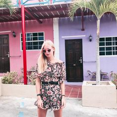 Janne (@radiatefashion) matches the colourful houses in Curacao with this gorgeous floral playsuit by My Jewellery! ☀