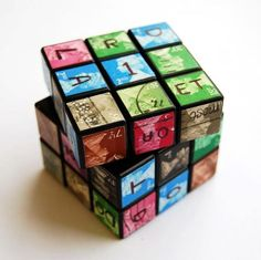 """An original and iconic Rubik's Cube, covered in trimmed British postage stamps (six different colours to correspond with the six faces), with a delivery address written across the cube. It was a problem trying to find a postbox that would accommodate this, but I struck gold on Albany Road. This was a more conceptual piece of postal art - it was about anonymously presenting a challenge to the Royal   Mail, seeing if they would solve a jumbled puzzle in order to make the delivery. """