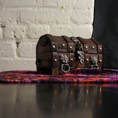 Use treasure chests for displaying favors etc.   Rustic Treasure Chest w Rennaisance / Gothic by RenegadeRevival
