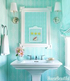 Turquoise infused morning light would start the day......just right! What a pretty powder room.