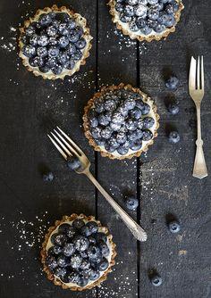 Blueberry Mascarpone Tartlets on dark food photography Just Desserts, Delicious Desserts, Dessert Recipes, Yummy Food, Sweet Tarts, Food Inspiration, Love Food, Sweet Recipes, Food Photography