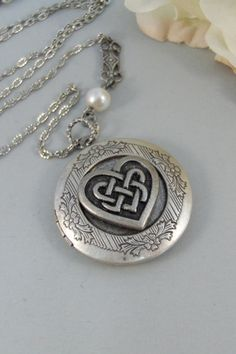 Celtic Heart,Locket,Silver Locket,Celtic Locket,Heart, Antique Locket,Celtic Knot,Irish,Lucky,Shamrock. jewelry by valleygirldesigns. $31.00, via Etsy.