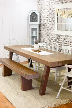 Dining Room with farmhouse table and faux brick wall, by TIDBITS
