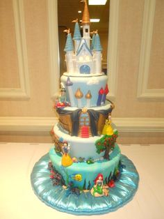I'm thinking for ZeeZee's party, I want this cake, but in just 4 levels. Top level being rapunzel's tower, next level being cinderella (maybe with sewing stuff around her or the little mice or something? I'm not really sure what her level should look like, i just know ZZ would be heart broken if Cinderella weren't on her cake), then the snow white level, and the bottom level as still being Ariel... LOVE!!! it-s-my-party