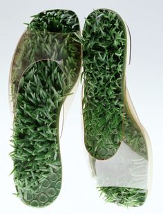 """""""Barefoot in the Grass"""" Sandals, Beth Levine: ca. 1968, astroturf and clear vinyl. """"Surreal and pop sandals. Through the upper made of transparent vinyl you can see the sole covered with artificial grass, and you can imagine at a glance how your feet would feel in this footwear. The synthetic materials which were popular in the 1960s stimulated human bodies optically and haptically with their artificial new textures..."""""""