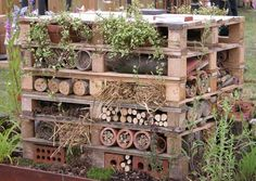 A wildlife stack - Insect Hotels - provide a home to pollinators and pest controllers. Tidy gardens, lawns and lack of dead wood, mean less and less habitat for wild bees, spiders and ladybugs.A wildlife stack can harbor numerous beneficial insects and amphibians. This habitat was made up entirely of recycled materials, the support is made up of old pallets. Image from: Cheshire Wildlife Trust, cheshirewildlifetrust.org.uk Have you thought about creating an insect hotel?