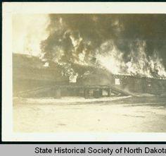 Garage fire at Civilian Conservation Corps camp near Watford City, N.D. :: State Historical Society of North Dakota (SHSND)