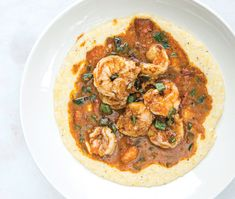 Shrimp & Grits with tomato gravy / The rustic texture and toasty corn flavor of stone-ground grits bear little resemblance to the bland porridge of Jason Starnes's youth. At South City Kitchen, he uses a blend of earthy, yellow grits from Mi Easy Shrimp And Grits, Southern Shrimp And Grits, Shrimp Grits, Charleston Shrimp And Grits Recipe, Spicy Shrimp And Grits Recipe, Cajun Recipes, Seafood Recipes, Cooking Recipes, Seafood Dishes