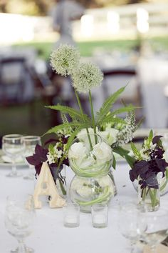 If we can get them in the big poofy guys here are called allium. Very dandelion like. We see them a lot in blue and purple too. White is a little more rare but it does have that look.