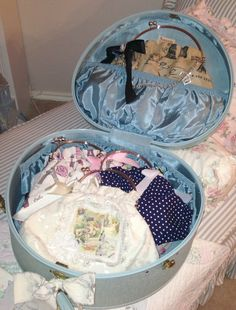 My mother had a blue suitcase like this when I was a child. I remember I was fascinated with the satiny pocket across the lid on the inside. I thought it was beautiful.