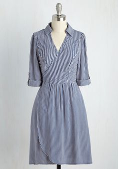 A weekend on the water is just what you need, and what better way to celebrate than sailing away in this striped wrap dress? Outfitted with a classic collar, tabbed sleeves for fluctuating temps, and a pair of pockets, this blue and white number is the 'anchor' to all your nautical style needs.