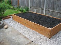 DIY raised bed. Looks easy enough. A few fence posts, 2x4s, bolts and gravel.