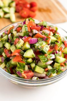 Bring Middle Eastern flavors into your home with this simple Israeli salad. Made with just five ingredients (six if you want to add in peppers!), this herby tomato cucumber side salad is the perfect pairing for the protein of your choice.