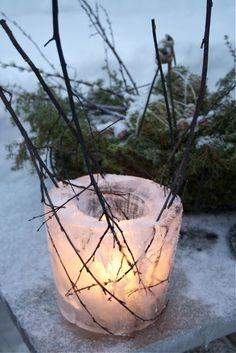 Icy Candle - Large coffee can with a small coffee can in center (weigh it down with some rice), then fill large can with water and freeze...great luminarias for your entryway to greet guests!!