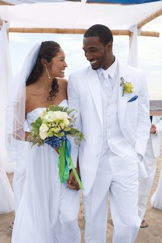 White sand beaches and azure skies are the perfect backdrop for this Pronto Uomo Two-Button White Satin Edge Peak Lapel Tuxedo.  Get $30 off each suit or tux rental plus more perks when you register at Men's Wearhouse.