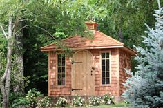 Non-typical round door and slim windows? Yes! Cedar Shingle Siding on the walls and as a decoration on a rooftop? Yes! With our many options, we can help you design the perfect garden shed! Potting Sheds, Potting Benches, Prefabricated Sheds, Charleston Gardens, Studio Shed, House Front Door, She Sheds, Outdoor Sheds, Rustic Gardens
