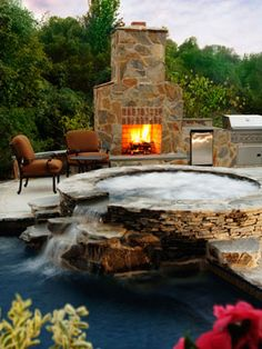 outdoor fire grill by waterfall jacuzzi. yes please. Water &  fire in the #garden