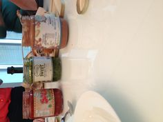 Some artisan condiments being tried during the taste testing of artisan submissions.