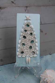 Hey, I found this really awesome Etsy listing at https://www.etsy.com/listing/114711101/seashell-christmas-tree-art