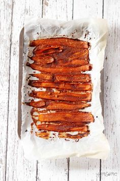a tray of baked vegan carrot bacon | yumsome.com